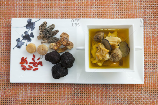 Tray of various mushrooms including some in water