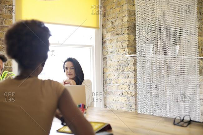 Two women working in office