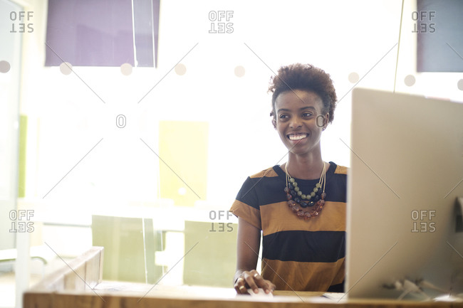 Woman in office at her computer