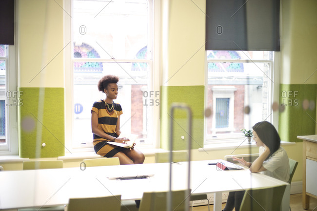 Two woman meeting in a conference room