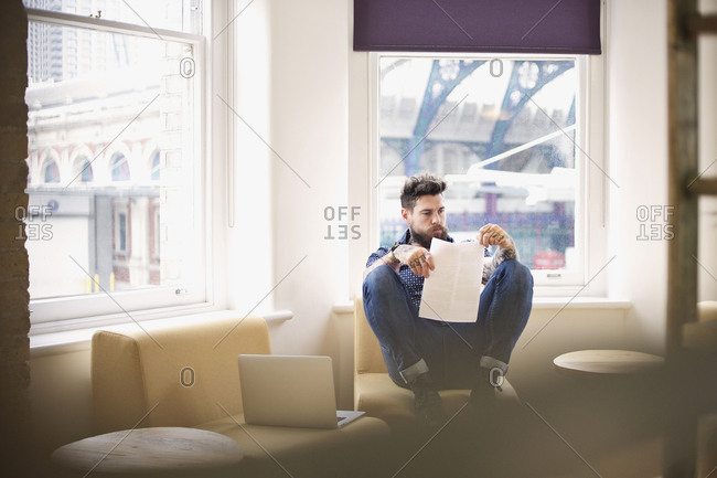 A man reading in an office