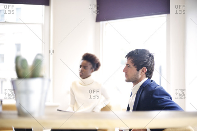 Two employees in a meeting