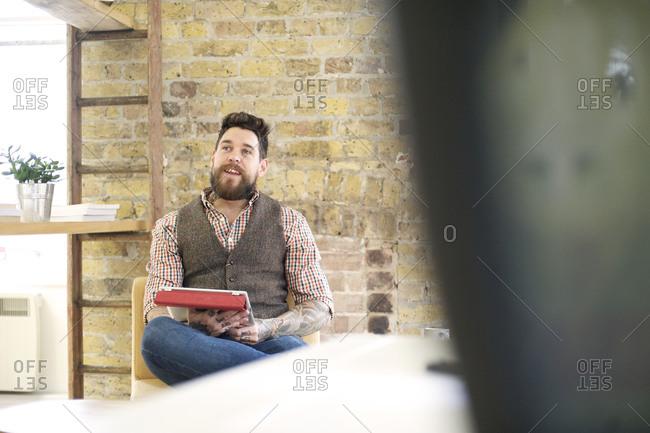 A man talking in an office