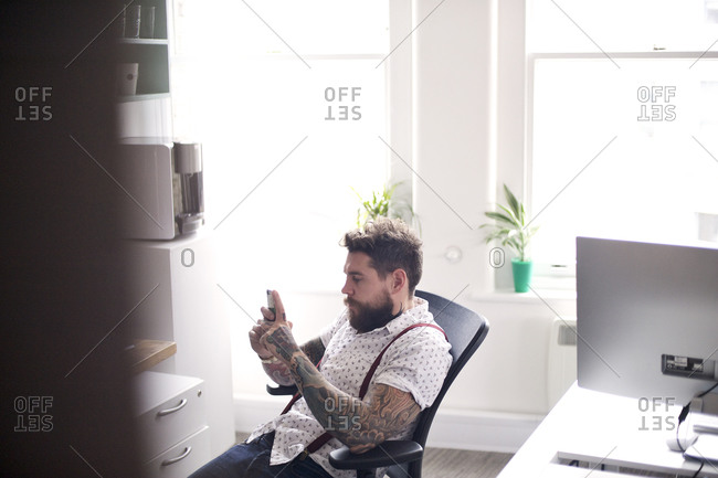 Man on break in office with phone