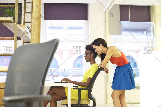 Two woman collaborating at work