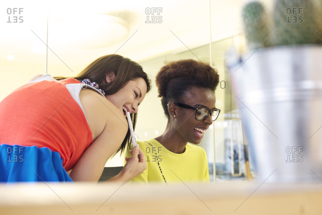 Two woman smiling at work
