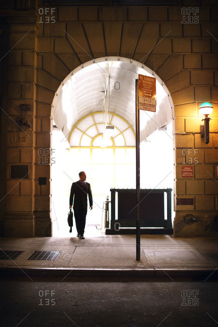A businessman at a subway station exit