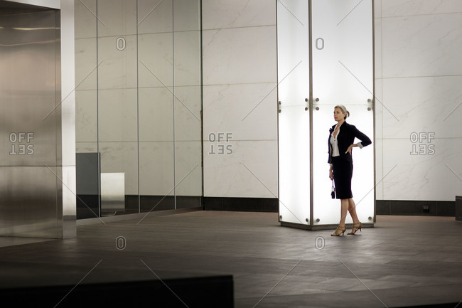 A woman standing in lobby