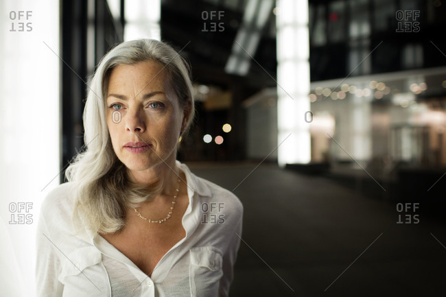 A woman in professional attire in office complex
