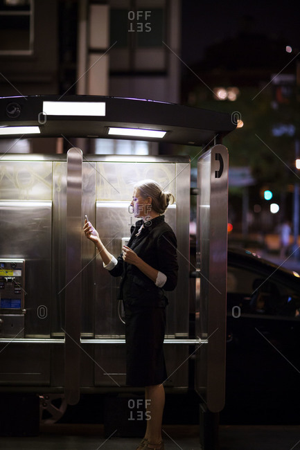 A woman by payphones