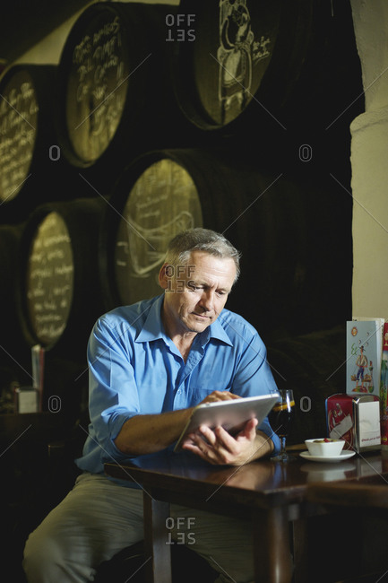 Middle-aged man using his tablet
