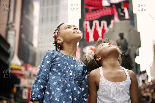 Two little girls looking around Times Square, New York