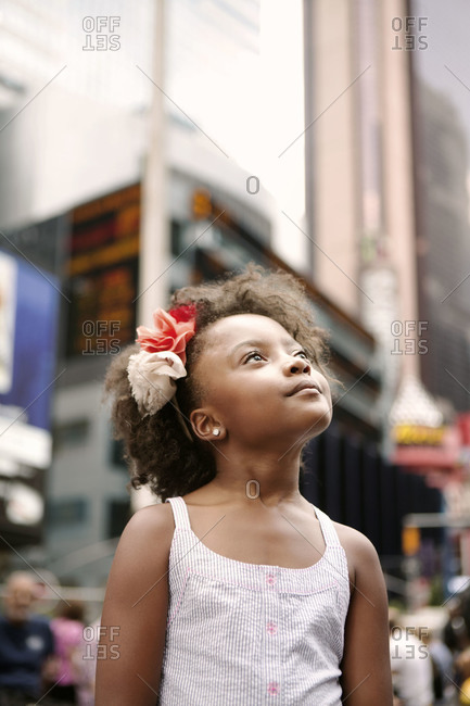 Little girl looking around Times Square, New York