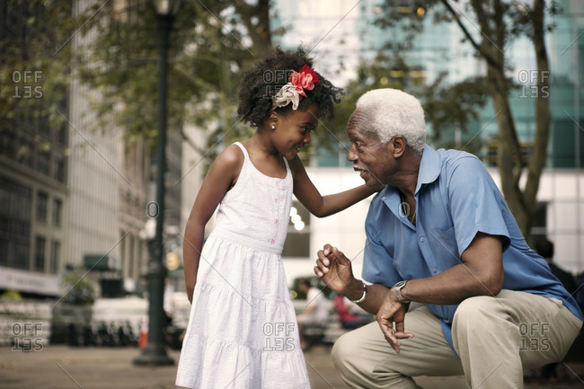 Grandfather talking to granddaughter, Bryant Park, New York