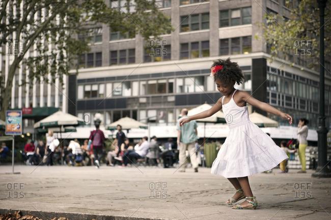 Little girl dancing in Bryant Park, New York