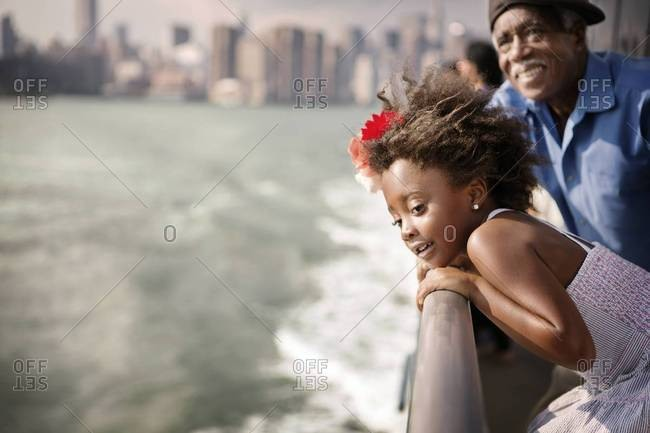 Grandfather and granddaughter on the East River ferry, New York