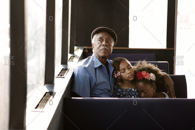 Grandfather and granddaughters on the East River ferry, New York