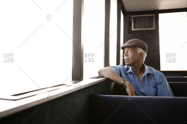 Elderly man on East River ferry, New York