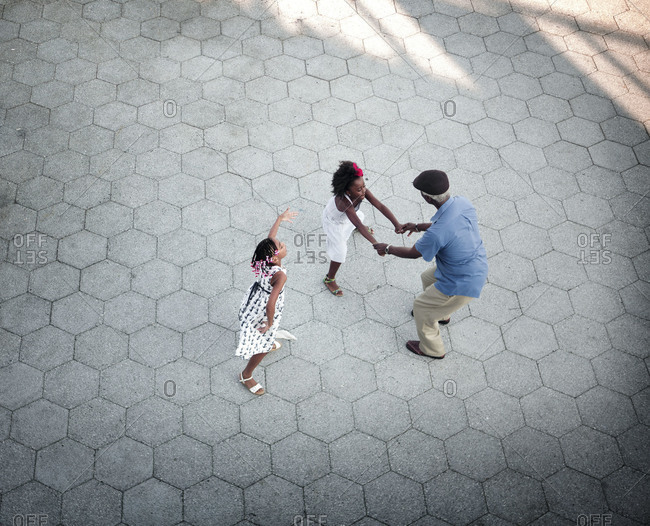 Grandfather dancing with granddaughters, New York