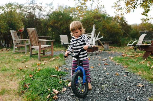 Little girl tries to ride a bicycle