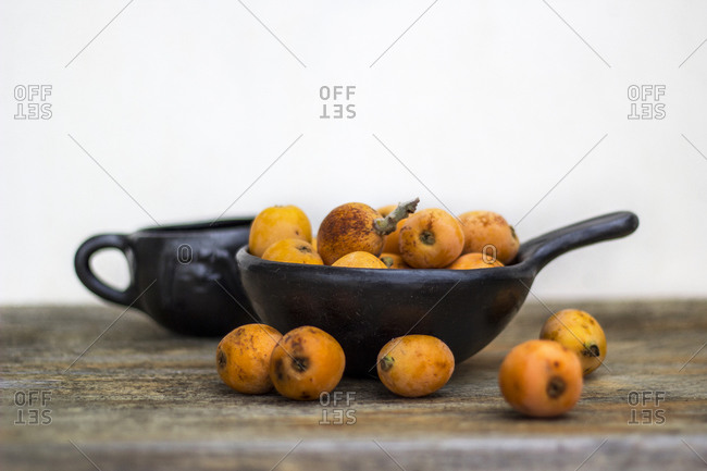 Still life of loquat fruits in ceramic bowls