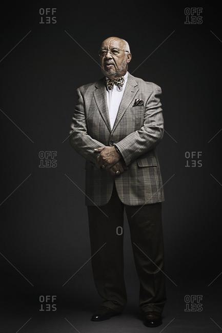 Portrait of elderly man in plaid jacket
