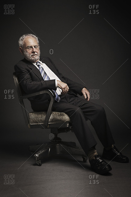 Portrait of an elder man sitting