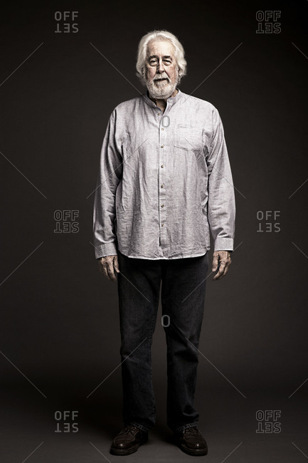 Portrait of an artsy elderly man