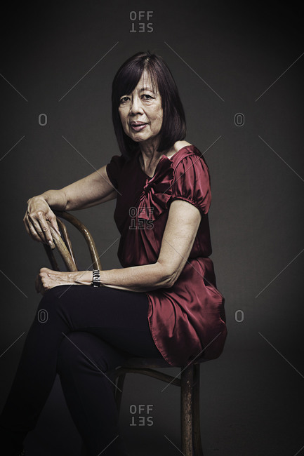 Elderly woman sitting on chair