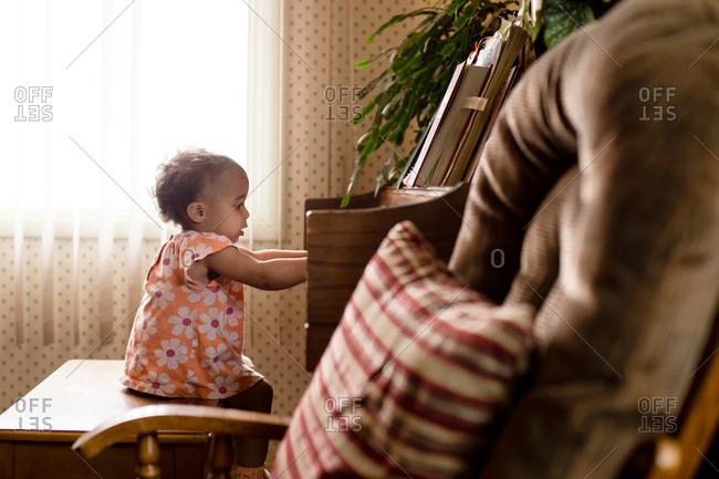 Toddler girl at piano