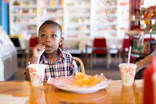 Young boy eating in a restaurant