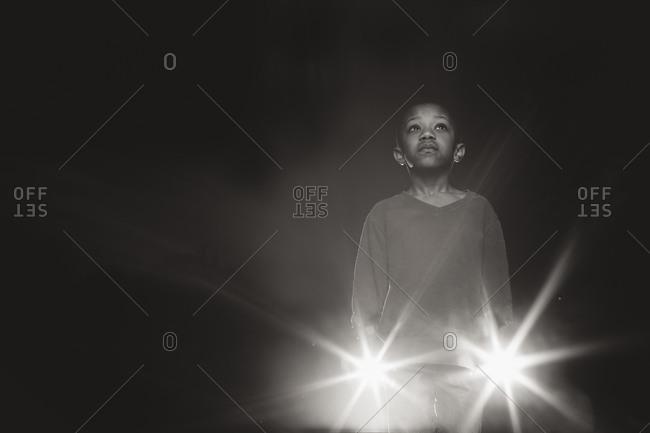 Boy holding two flashlights
