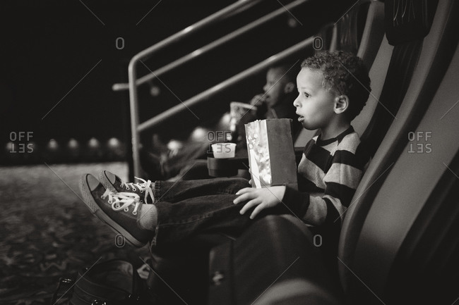 Boy at movie theater with popcorn