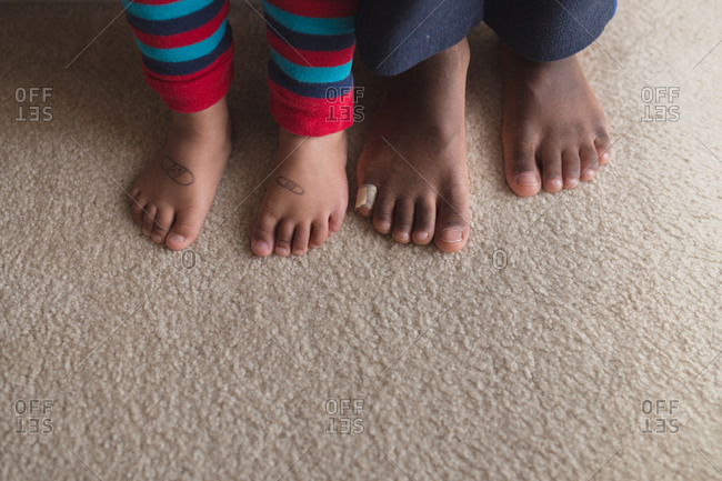 Close up of children's feet with bandage and bandages drawn on