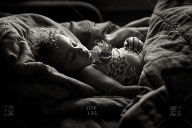 Young girl sleeping in a bed