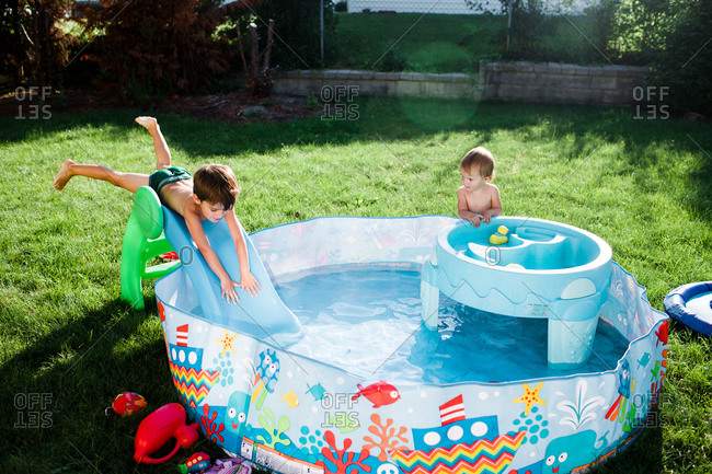 Two children play in a kiddie pool