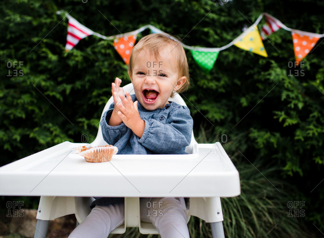 A baby laughs during her birthday part