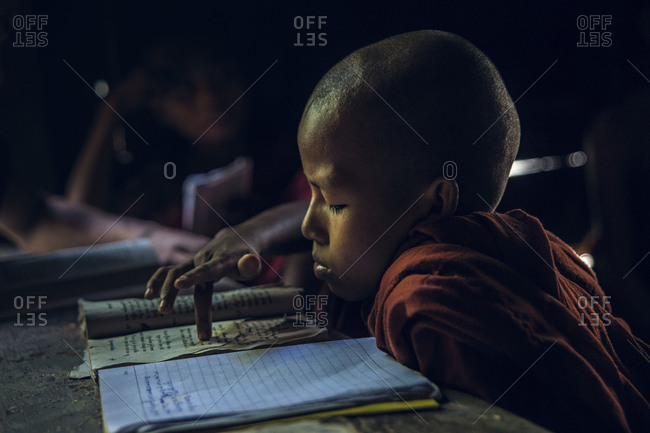 Mandalay, Burma - September 4, 2012: Young Buddhist monk studying in a monastery