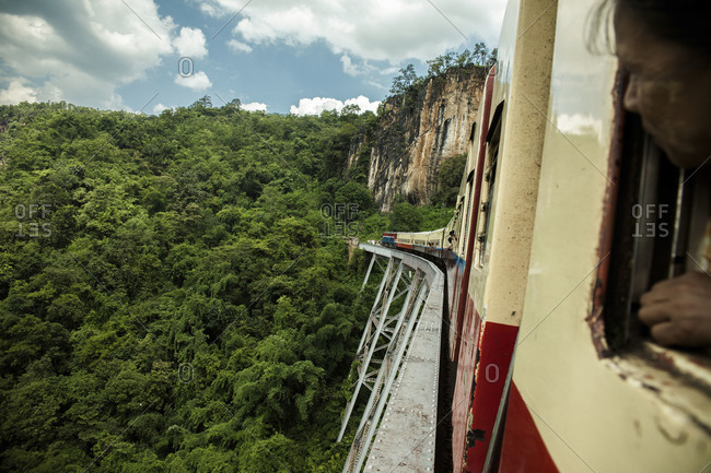 Myanmar, Southeast Asia - September 6, 2012: Train crossing a bridge on the way to Hsipaw