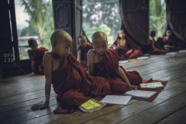 Myanmar, Southeast Asia - September 13, 2012: Buddhist boys studying in a Burmese Monastery