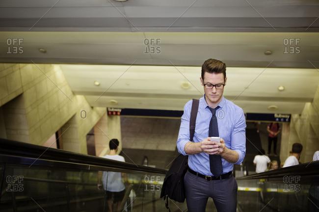 A man on a subway escalator