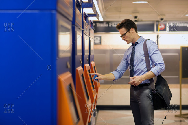 A man purchasing train tickets