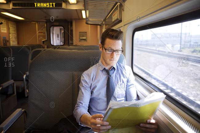 A man riding a commuter train