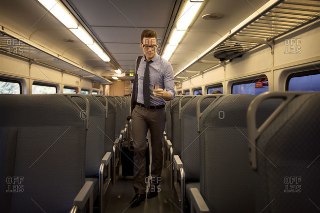 Man in commuter train aisle