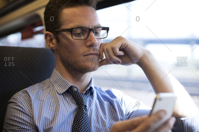 A man reading on commuter train