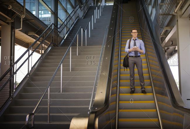 Man going down escalator