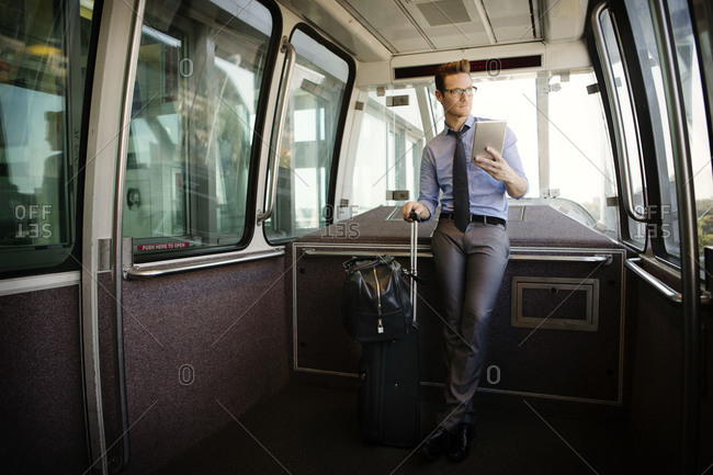 Man in airport light rail tram