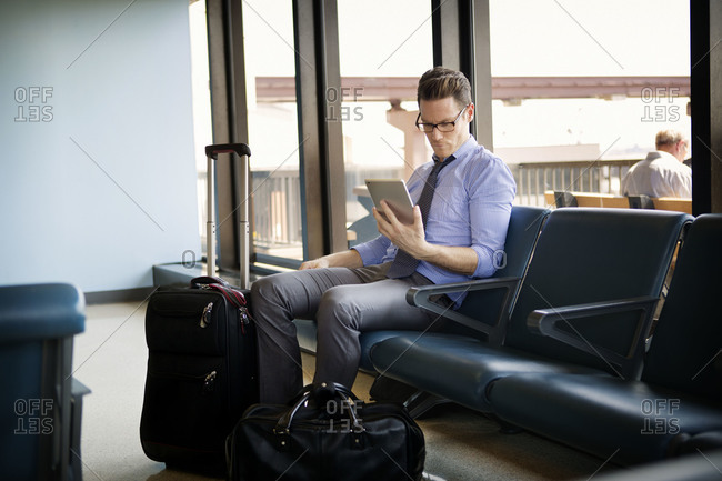 Man sitting in airport waiting area
