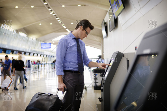 Man at automatic check in at airport