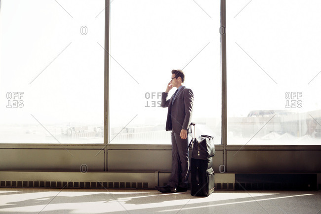 Man in airport terminal on phone